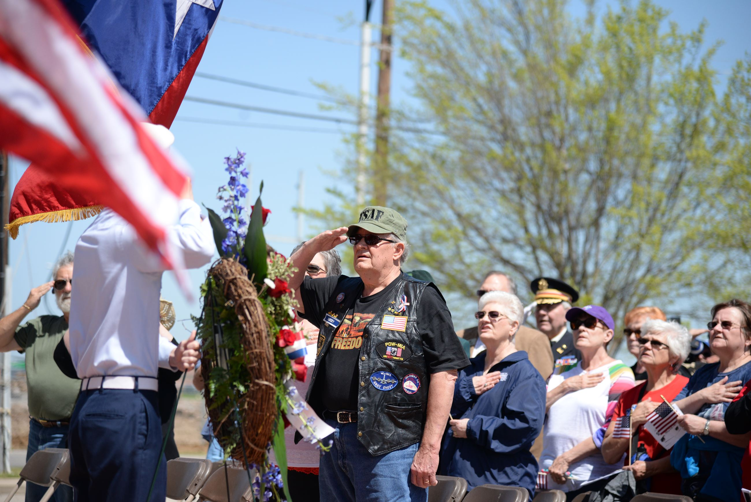 Vietnam Veteran saluting flag
