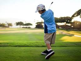 child swinging golf club