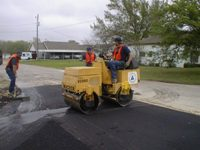 Paving a road on a roller