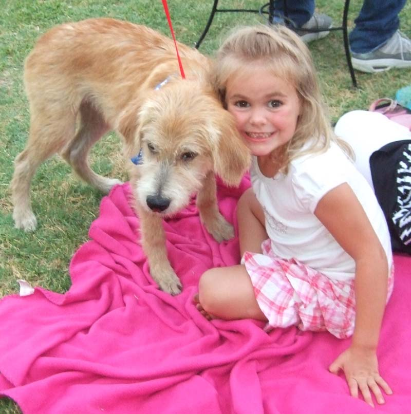Photo of little girl with dog Harry-Yappy Hour at Lone Oak Winery