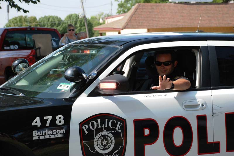 photo of police officer in car leading July 4, 2012 Parade